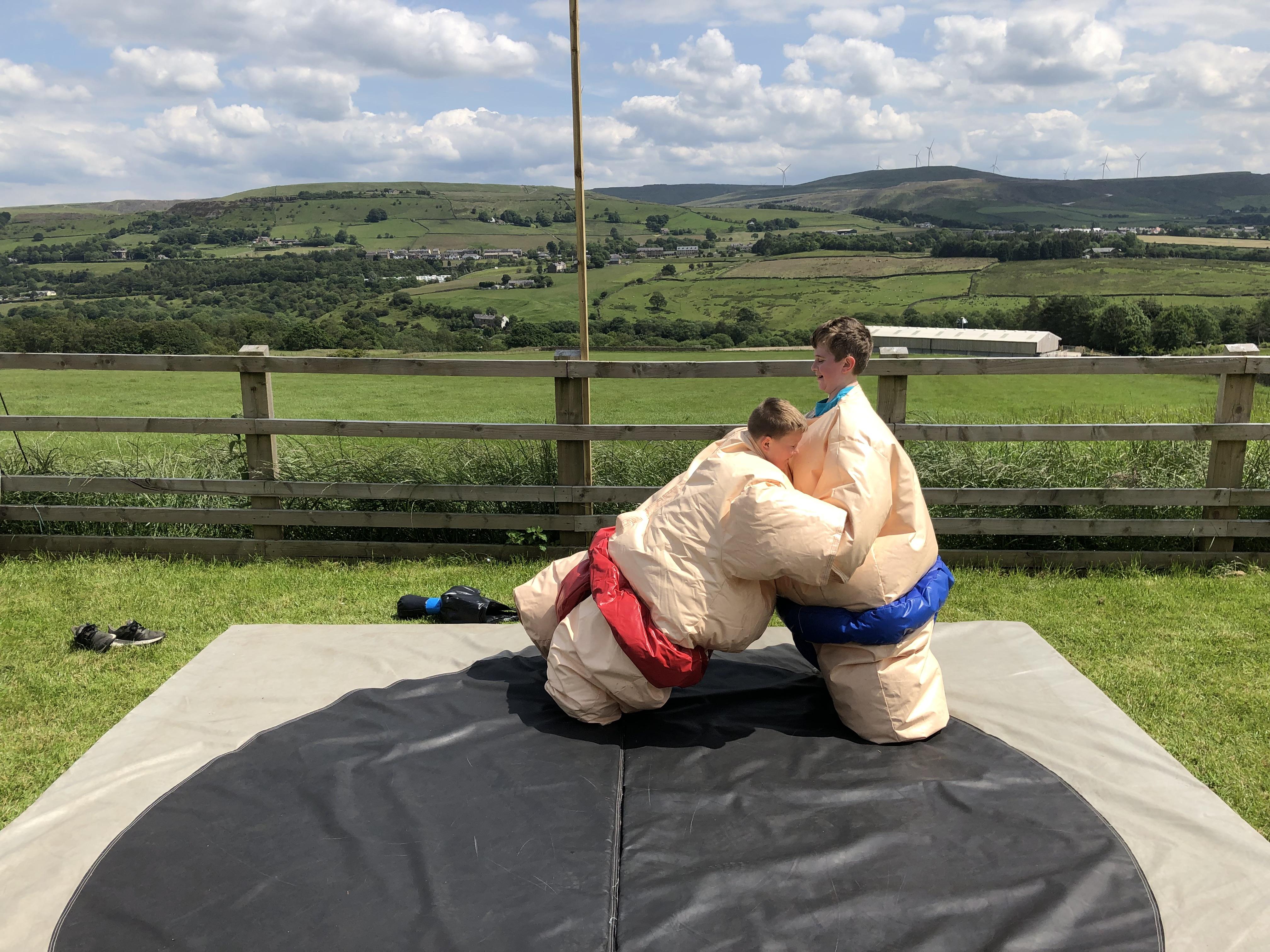 Kids in sumo suits